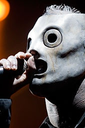 Slipknot was formed in Des Moines, Iowa, in September 1995 when drummer Shawn Crahan and bassist Paul Gray started a band named The Pale Ones.[1] The lineup was made up of friends who met through the local music scene, including vocalist Anders Colsefni and guitarist Donnie Steele