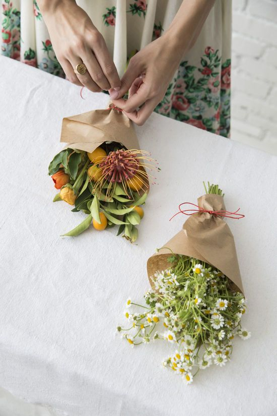 Wrap some inexpensive flowers in craft paper. Fill up a basket and pass them around to people you see. This project is supposed to be fun, affordable and doable for all!