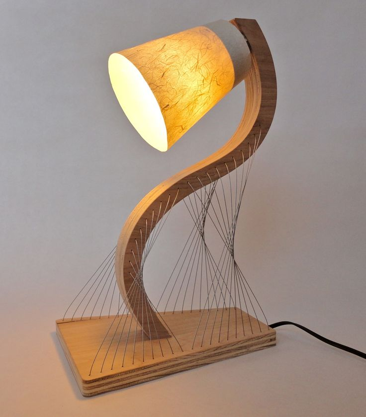 S-Curve Lamp by Robby Cuthbert. Steel cables provide tension and hold everything in place. The final version will be cut from a bamboo plywood that is darker in color.  like,