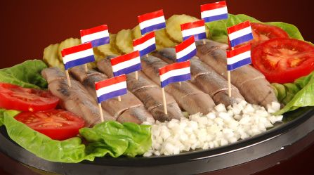 Hollandse Nieuwe; Raw Herring fish with unions,typecal Dutch treed together with jonge grean jenever(spirit like wodka)