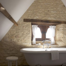 dont like this stone , too montone, not enough contrast between stone and mortar ,attic bathroom...