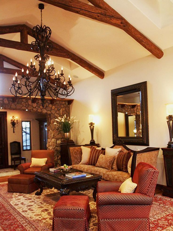 A rustic atmosphere is created in this Spanish-style living room with wood  ceiling beams