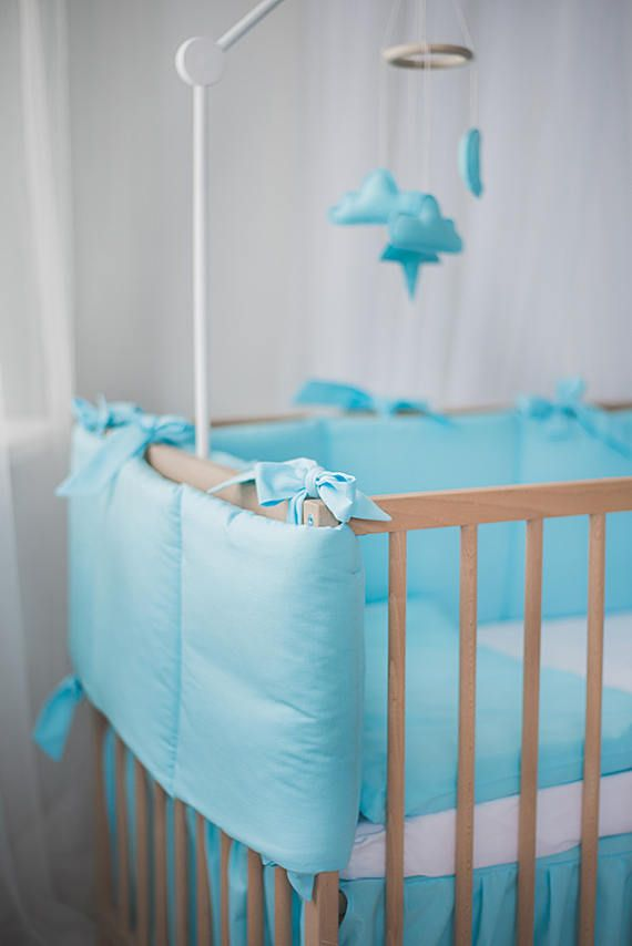 Blue baby nursery bumper, boy bedding, crib guard, blue crib bumper  Soft but firm crib bumper is a must to ensure baby's safety and create outstanding nursery design. Manufactured in pastel colors, cot bumper looks modern yet cozy and sweet. Decorated with big ribbons to add some extra charm. - Filled with padding - Height 30 cm - Cot size: 69x132cm (27x52inches); 70x140cm (27.5x55 inches); custom size; - 100 % cotton fabric  If you need other sizes, please contact me!  You may wash in…