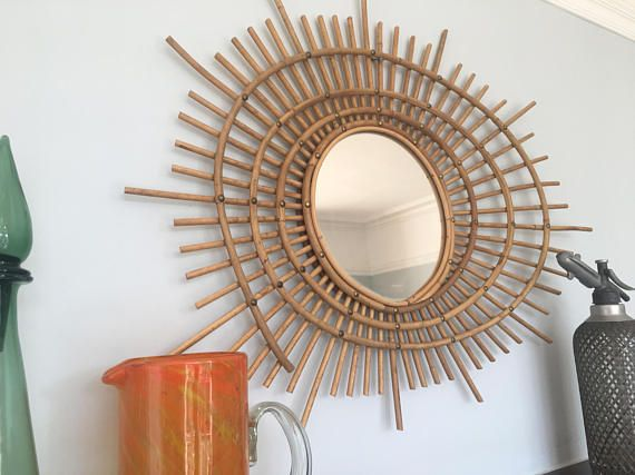 Very unusual large vintage sunburst rattan mirror in excellent condition. Asymmetric mid century design. Not the normal sunburst design.  Would hang well in any home.  Dimensions: Height - 25.25 inches/64 cms (at its highest)  Length - 32.75 inches/83 cms (at its widest)  Mirror diameter - 9.5 inches/24 cms  Check out my other items on www.etsy.com/uk/shop/verylastcentury  I do not make any money on shipping and will refund any excess. The shipping prices given a...