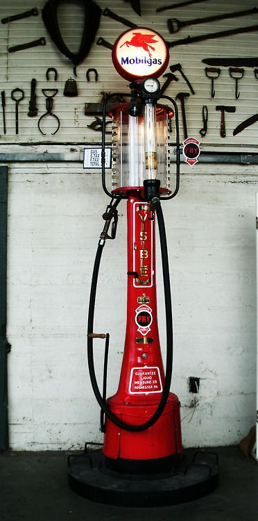 old gas pump. Handle on the side pumped gas up into glass tank for measuring, then drained into your car.