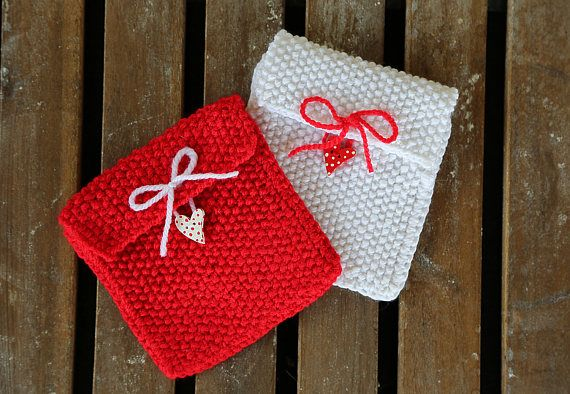 Set of 2 knitted gift bags. Red knitted gift bag. White