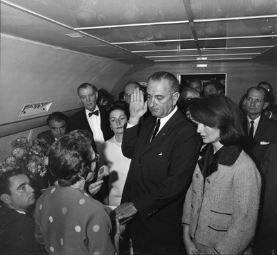 Jackie O, watching her husband be replaced.