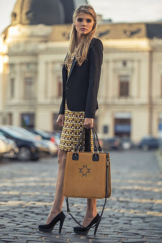 With yellow and sophisticated embroidery pattern the Business handmade leather tote will become your favorite accessory. If you ever felt that keeping together your laptop and personal necessities while on the run is impossible, the Business tote will prove you that it isn't. Designed for busy working days, this elegant handbag is greatly spacious and will help you be organized #busta #bustabags #leatherbag #streetstyle #blue #embroidery #folklore #office #business #interview #clothes #bag