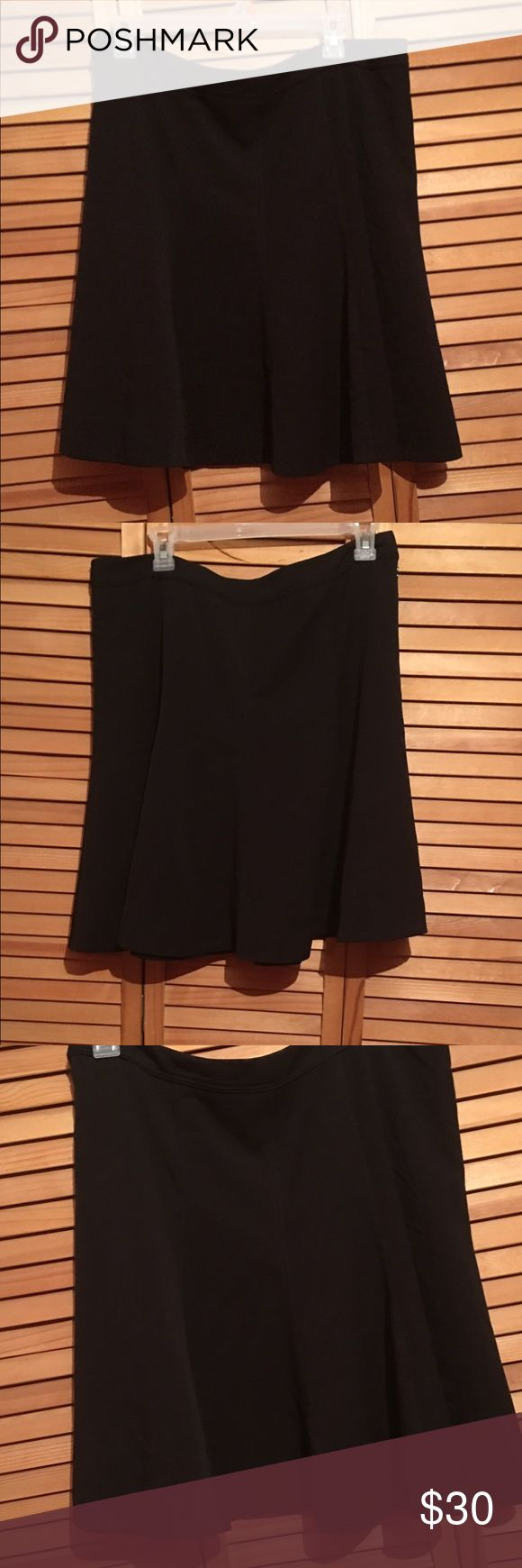 "WHITE HOUSE BLACK MARKET BLACK PEPLUM SKIRT White House Black Market black peplum skirt, side zipper, lined, 63% polyester, 32% rayon, 5% spandex, approx 21"" long, gently worn once, size 12, label is torn but still attached White House Black Market Skirts"