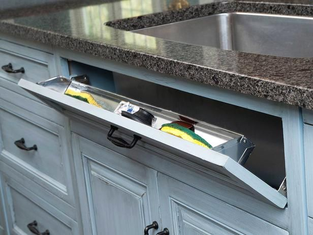 20 Smart Kitchen Storage Ideas : Rooms : Home & Garden Television. Handy Sing Storage. hidden hinges and a stainless steel tray hides sponges and scrub brushes! LOVE IT!