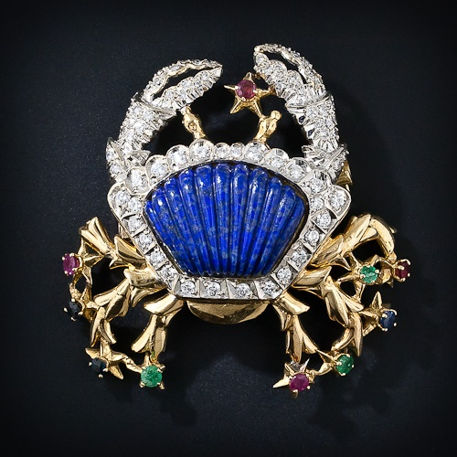 14k gold Crab/ body: lapis lazuli, diamond encrusted shell and pincers, legs dotted with emeralds, rubies and sapphires