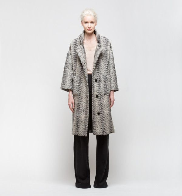 Long grey wool statement coat with specks of pink and a slightly oversized fit. Button closure. Made with minimal waste, sustainable fabrics, fair trade and locally in New York City by out highly skilled tailors. Materials: Reclaimed Wool The Facts: After agriculture, the fashion industry is the second largest user of our world's water. The Power of Fashion: Each H Fredriksson piece is created in New York City using new sustainable fabric technologies that have lower environmental impacts…