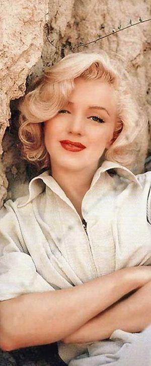 Marilyn. Rock sitting. Photo by Milton Greene, 1953.