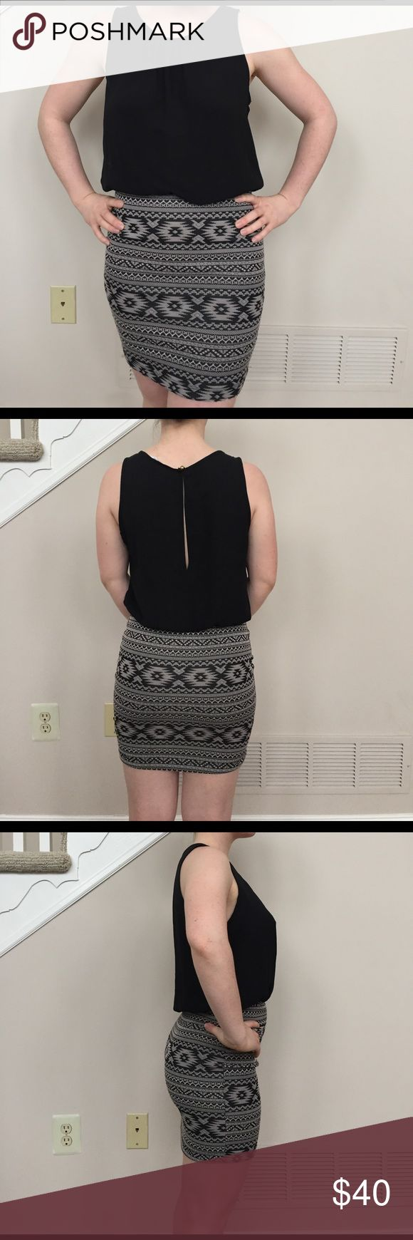 """A classy short dress A mid thigh length dress, with the illusion of a skirt/blouse combo. Black flowy top half, tight skirt with woven-in tan Aztec pattern bottom half. Skirt is stretchy and good quality material. Top is thin nylon material but not see-through. back has small teardrop opening that is clasped together with gold loop button. (Model is 4'11"""" and 110lbs) voxx Dresses Mini"""