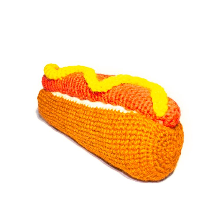 Brought to you from luxury boutique Ware of the Dog in New York City, this hot dog toy will make a fun and original addition to your dog's toy collection!   100% Lambswool, made with all natural dyes
