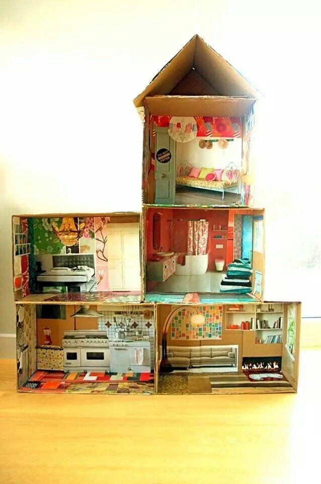Poppenhuis van dozen en tijdschriften