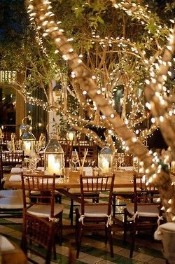 Use the garden trees to provide lighting for outdoor events