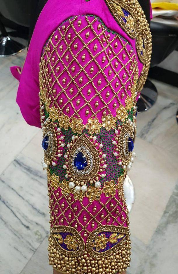 808b141491216f 30.Thilagam stone and jardosi work blouse design   40 Heavy Maggam ...