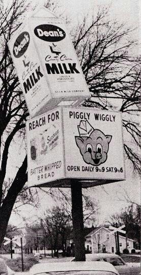 This Piggly Wiggly sign is just like the one where I used to work. I'll never forget the time the milk carton fell off. Good thing cars were made of real metal then.