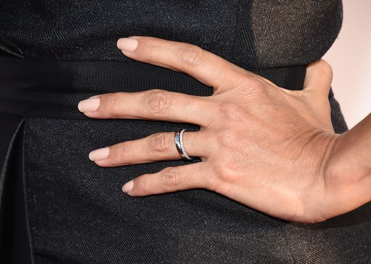 Eva Longoria Swaps Her Engagement Ring for Two Wedding Bands via @WhoWhatWear