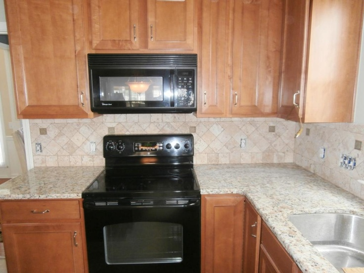 Giallo napoli granite countertops installed in charlotte for Charlotte kitchen cabinets
