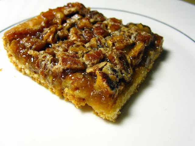 Pecan Bars  1 can of refrigerated crescent rolls  1/2 cup chopped pecans  1/2 cup sugar  1/2 cup corn syrup (dark or light, doesn't matter)  1 Tbsp butter, melted  1/2 tsp vanilla  1 egg, beaten  8 min.@350