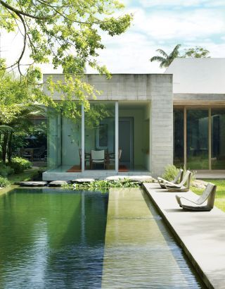 Contemporary Pool by Isay Weinfeld. AD. Poolside Cement Loop Chairs, Willy Guhl.  Chemical Free Water Purification System.