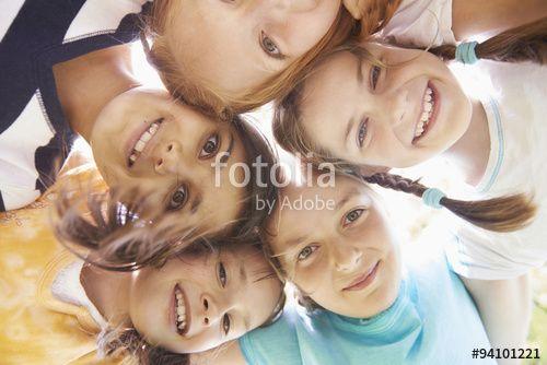 """Laden Sie das lizenzfreie Foto """"Directly below shot of five girls playing in huddle, Bavaria, Germany"""" von MITO images zum günstigen Preis auf Fotolia.com herunter. Stöbern Sie in unserer Bilddatenbank und finden Sie schnell das perfekte Stockfoto für Ihr Marketing-Projekt!"""
