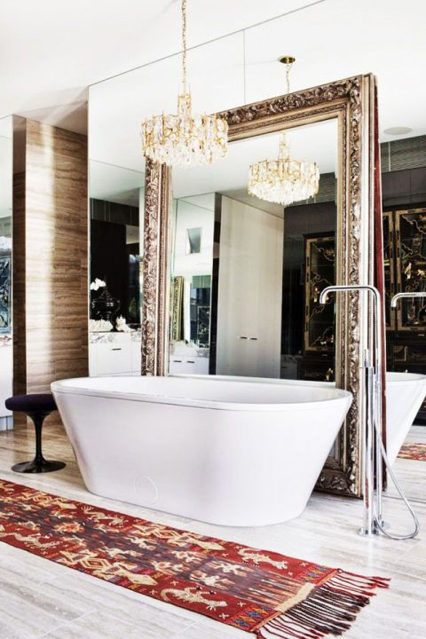 Not only does a mirror open up a room, but one that's oversized with gilded tones looks nothing short of regal. Via David Hicks