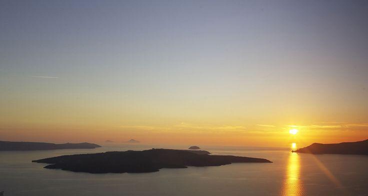 Sunset over the Santorini caldera and volcanic island