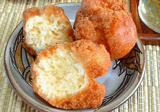 Andagi (Okinawan Doughnuts) is a traditional food item during Hawaii's Bon Dance season (summer months).  It is not overly sweet & not dusted in sugar.