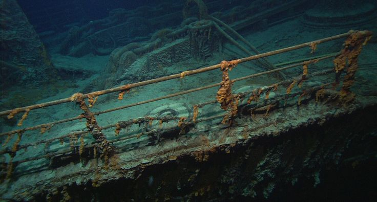 next previous  The Titanic's port bow rail, chains and an auxiliary anchor boom. Dr. Robert Ballard, the man who found the remains of the Titanic nearly two decades ago, returned to the site and lamented damage done by visitors and souvenir hunters. Close