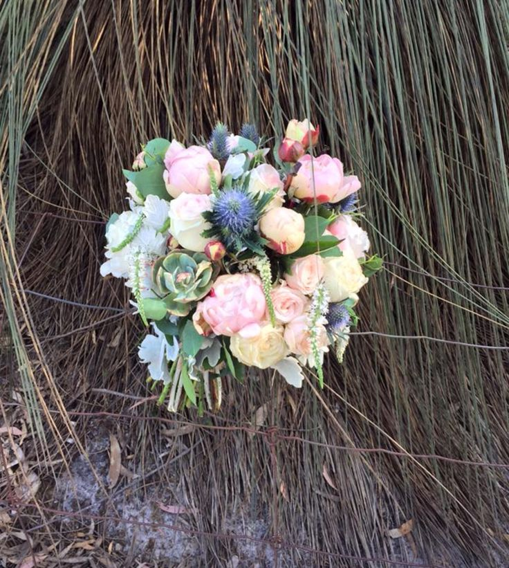 Muted tone bouquet with roses and peony.