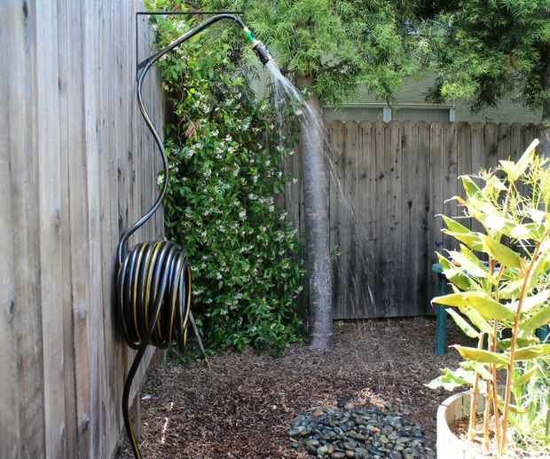 Outdoor shower hose hookup