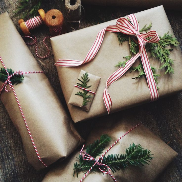 Creative way to wrap presents. Brown paper, red and white striped ribbon, and little pieces of a Christmas tree!