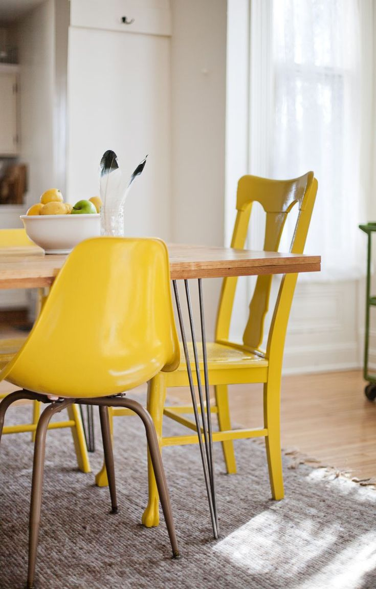 Paint different style chairs the same color to make it cohesive.