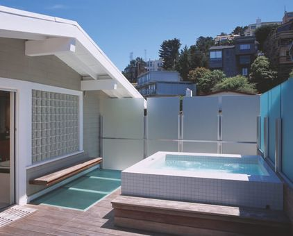 Hot tubs and swimming pools are great places for creating a wind shadow. The screen may also help to give privacy. An outdoor shower is another good spot to protect from the wind. Goosebumps, be gone.