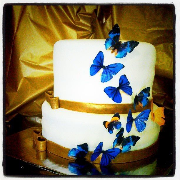 - The theme for the wedding is royal blue and gold with butterflies. The cake is actually a royal blue velvet cake with cream cheese frosting. The butterflies are made with edible rice paper. The golden color from davids bridal is actually more of a khaki color with shimmers.....so thats what I did.