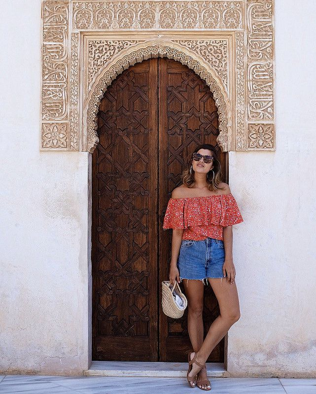 You can never have enough photos in doorways. Head over to the blog for the guide to Granada, Spain!