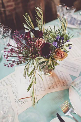 This 1920s Wedding In A Brooklyn Speakeasy Is So Awesome #refinery29  http://www.refinery29.com/100-layer-cake/17#slide14  Love how they used tea-stained music sheets as their table runner. Such an inexpensive idea!     Florist: Tom Borgese