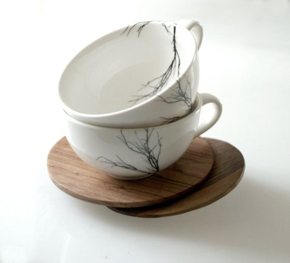 Porcelain teacups with wooden saucers from Lovemilodesign on etsy. $38.00