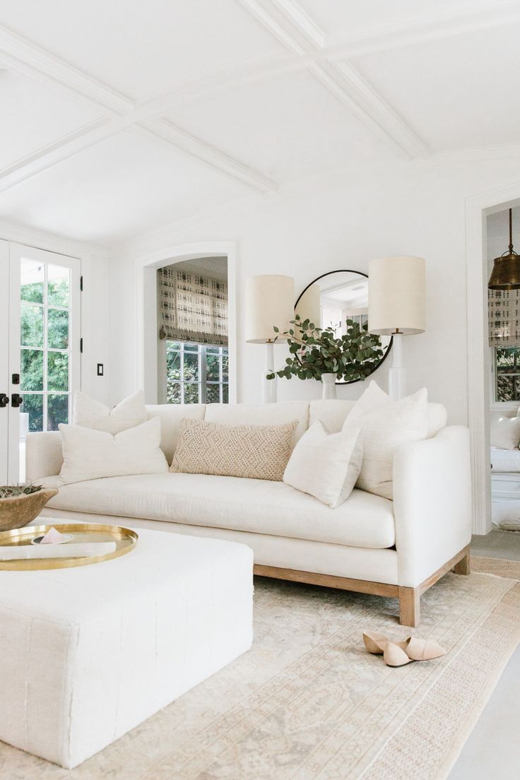 erin fetherston's california home | off white living room | light floors |  white couch gold