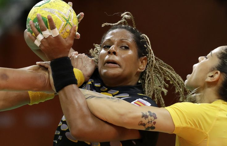 Spain's Marta Mangue, center, struggles for control of the ball with Brazil's…