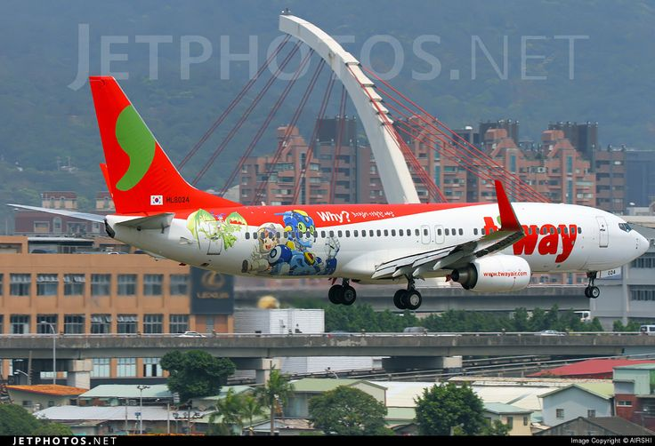 T'Way Airlines (KR) Boeing 737-8HX HL8024 aircraft, with the sicker ''WHY'' on the airframe, on short finasls to Taiwan Taipei Songshan commercial & military Airport. 20/03/2015.