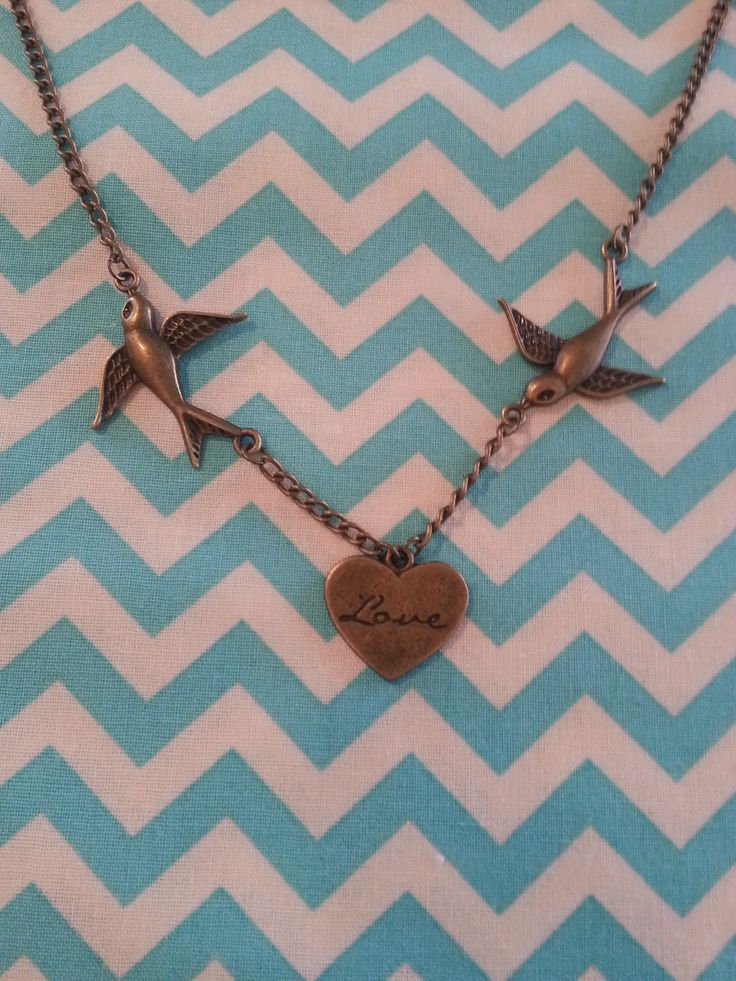 Swallow and love heart necklace.