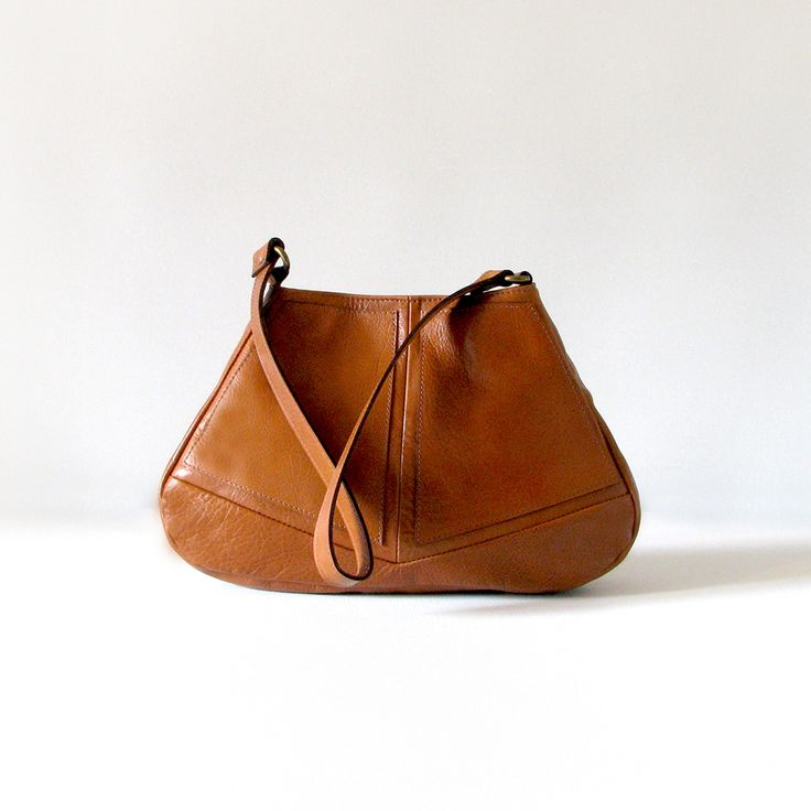 The sleek handmade Diamond Hobo handbag is made from quality tan cowskin leather.