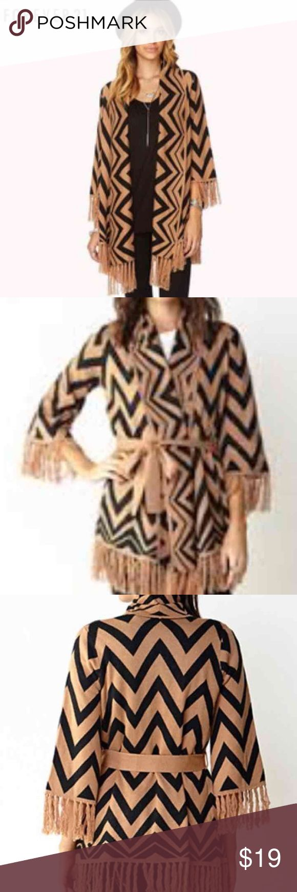 Forever21 Chevron Aztec Print Cardigan Medium In like new condition, only wore once however it was too big on me. Gorgeous zip zag chevron print thick cardigan. Comes with a self tie sash, super soft and comfortable. Price is firm, fast shipping from California. Originally paid $34.90. Size-Medium Could also fit a large, runs a half size bigger due to it being from the contemporary collection. Forever 21 Sweaters Cardigans