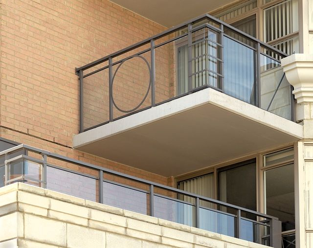130 Pond Drive - Glass with decorative metal railings by Greco Aluminum Railings