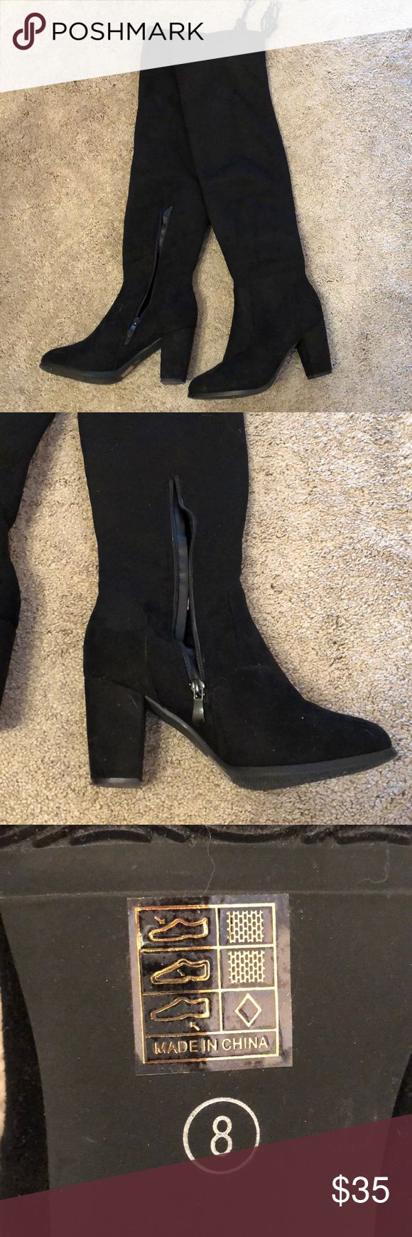 Over the knee black boots Black suede boots, go above the knee with tie on top Worn once These are super warm but I have very skinny calves and they just looked too big! Shoes Over the Knee Boots