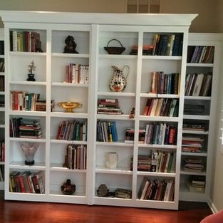 White Murphy Bed with pivoting bookcases